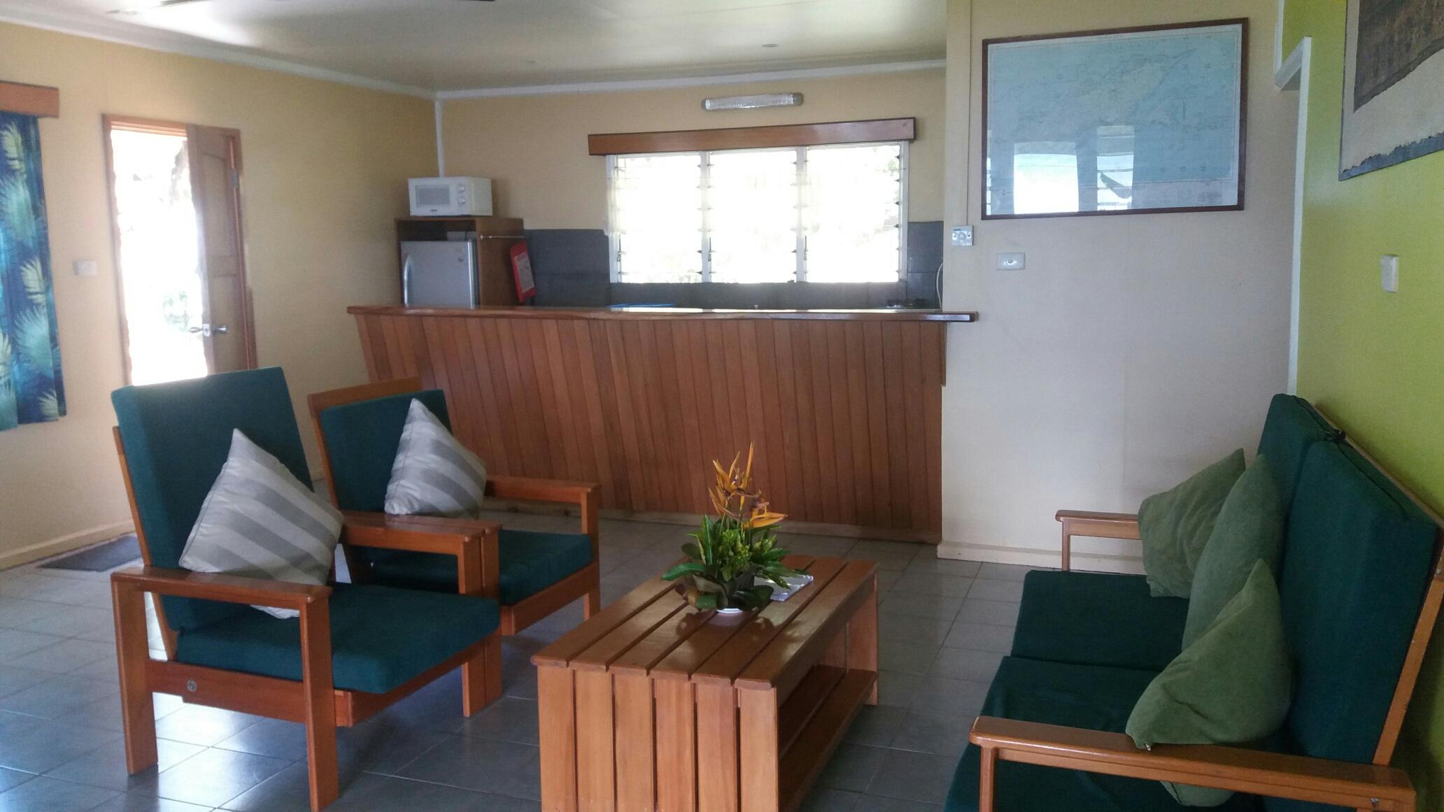 The lounge and kitchen of the Beach House at Daku Resort, Savusavu.